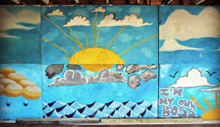Murals inside a blighted home that has been turned into an art/play space for local children.