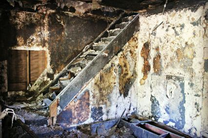 Inside the burned-out shell of a home that will soon be demolished