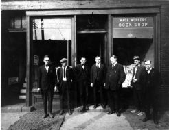 """Photo via Wayne State's Reuther Library. William """"Big Bill"""" Haywood poses for a photo outside of the Wage Workers Book Shop, located at 278 Gratiot Avenue 1919-1920."""