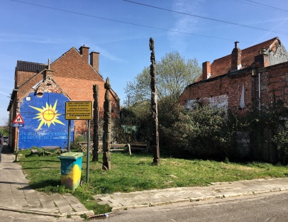 """The sign reads """"Doel--Inhabited Town. Respect the residents. Do not enter the houses."""""""